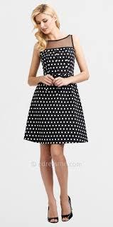 black and white polka dot dress with blue shoes style guru