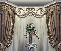 a luxurious design of the bay window the golden curtains the