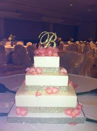 bling wedding cake toppers gold bling wedding cake with coral roses and rhinestone initial