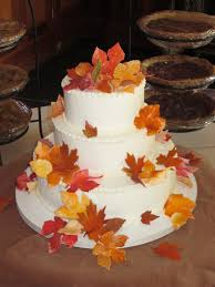 thanksgiving cake decorating ideas fondant fall leaves adorn this simple wedding cake in butter cream