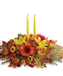 heavenly image of orange flower candle thanksgiving floral