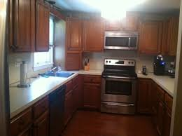 how to update oak kitchen cabinets before and after whats the best way to update oak kitchen cabinets