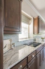 Backsplash Kitchen Ideas by Fantasy Brown Granite With Backsplash Sw Repose Gray Paint