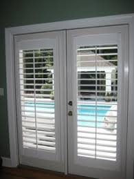 Window Dressings For Patio Doors Modernize Your Sliding Glass Door With Sliding Plantation Shutters