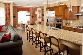 kitchen four brown chairs and kitchen table made of marble plus
