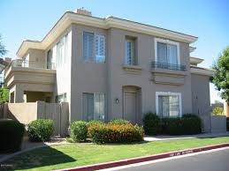 exterior home colors with stone and front field accent design
