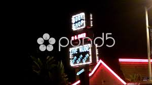 led lights for body shop body shop strip club sign sunset boulevard west hollywood ca