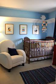 Rugs For Girls Nursery Blue Wall Themes With Picture Frame Combined By Brown Wooden