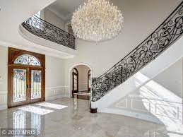 traditional entryway with simple marble tile floors u0026 arched