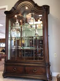 cherry curio cabinets cheap this cherry curio cabinet gets your attention large and tall in