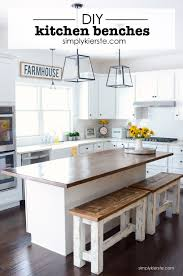 farmhouse kitchen with shiplap plank ceiling and beadboard island