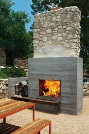 modern outdoor fireplace in the patio with exposed aggregate