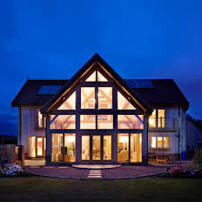 a family timber barn style house
