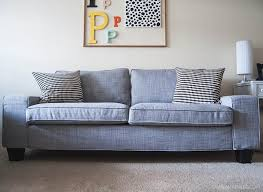 ikea sofa hacks she added bed risers and this sofa looks normal instead of short