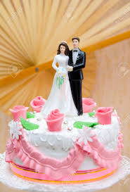 wedding cake top plastic and groom on top of wedding cake stock photo