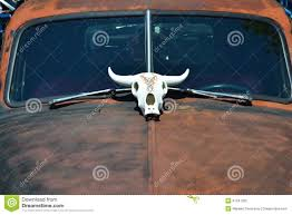 cow skull ornament on the of classic rat rod stock photo