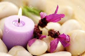imagenes flores relajantes candle and lavender flowers in stones relaxing time stock photo