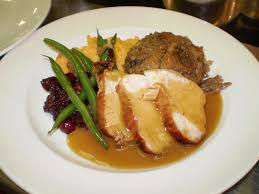 plate of thanksgiving food strip house presents seasonal and thanksgiving day specials