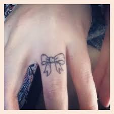 tattoo on finger bow cute tiny bow tattoo on finger
