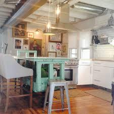 kitchen island with shelves white kitchen cabinets white tile backsplash silver foating open