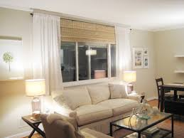 Hanging Curtains High And Wide Designs Make Your Picture Windows Look By Hanging Bamboo Blinds And