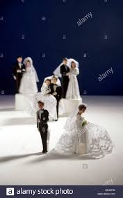 and groom figurines divorce metaphor with cake toppers and groom figurines