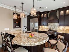 kitchen island with built in table from the rounded end of the island great seating area