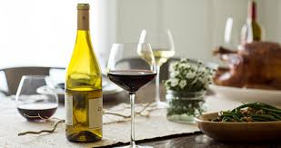 a buffet of thanksgiving wine pairings and dishes food wine