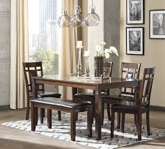 Dining Room Table And Bench Set by Ashley Furniture Bennox Brown Finish 6 Pc Dining Table Side Chairs