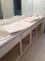 the redeemed home bathroom cabinet makeover