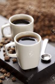 Modern Coffee Mugs Two Modern Espresso Cups On A Wooden Table Stock Photo Picture