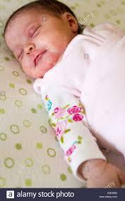 Baby Sleeping In A Crib by Newborn Baby Sleeping In Her Crib Stock Photo Royalty Free