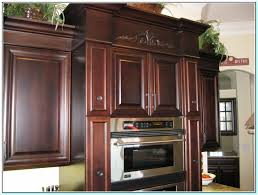 Staining Kitchen Cabinets Darker by Staining Kitchen Cabinets Dark Cherry Torahenfamilia Com