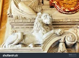 magnificent sculpted lion part marble fireplace stock photo