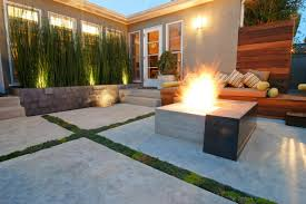 flooring modern outdoor living space with fire pit and wooden