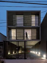 three story building three story apartment building proposes a provocative dialogue with