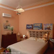 peach bedroom and light orange wall