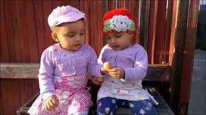 babies eating lemon for first time so cute twins girls