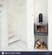 a small cast iron log burning stove fire with wooden logs