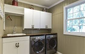 cabinet over the dryer as laundry room storage solutions home