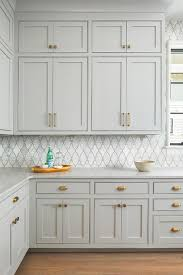 light gray kitchen cabinets stacked light gray kitchen cabinets with marble arabesque