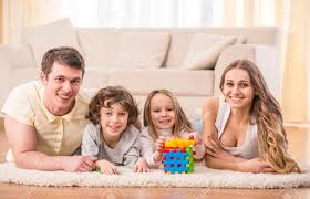 Happy To Be A Family Portrait Of Happy Family With Kids In Living - Family in living room