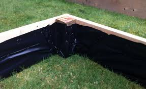 Wood For Raised Vegetable Garden by Staple Plastic Sheeting To The Inside Of Raised Beds U2013 To Help