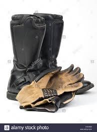 black motorcycle boots black motorcycle boots and worn gloves stock photo royalty free