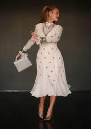 white dress beyoncé wearing a white dress with birds popsugar fashion