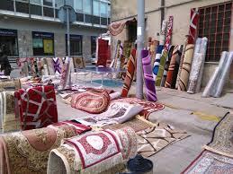 venditore di tappeti venditore di tappeti taroccati in fiera spacciati per persiani