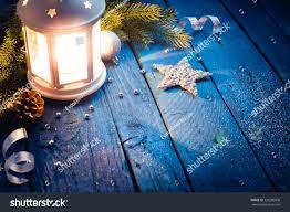 christmas lantern decorations on blue wooden stock photo 520280008