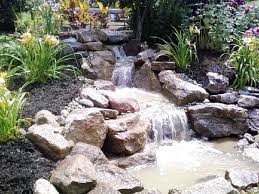 rock waterfalls backyard natural look waterfall cascade green