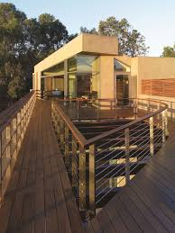 exterior modern balcony with wooden floor planks and cream puff