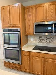 should i paint my kitchen cabinets or stain them e design 3 painted oak maple kitchen cabinet projects